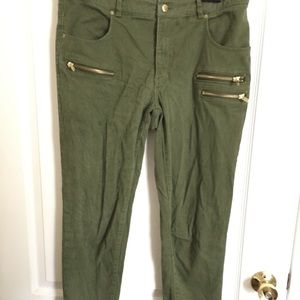 Green cargo pants with gold zippers